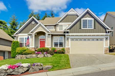 house with a red door and a landscaped yard for curb appeal when staging