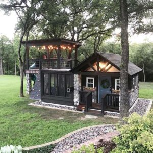 She shed with lighted tree top deck